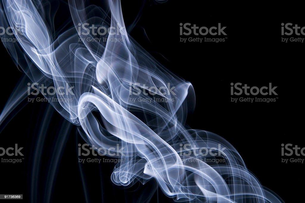 blue smoke on black royalty-free stock photo