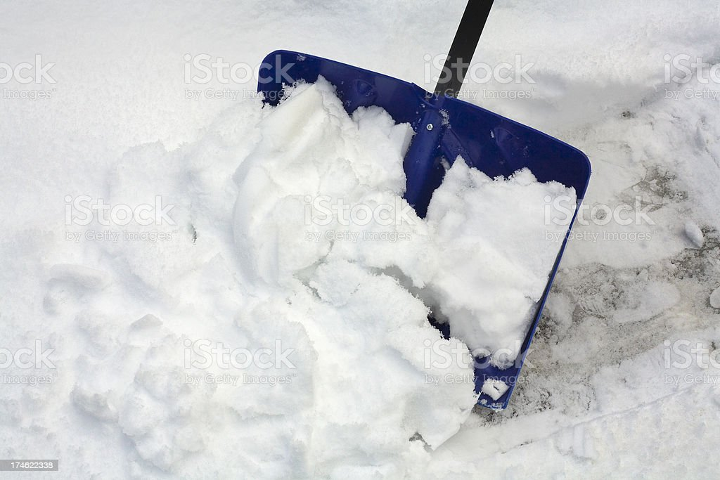 blue snow shovel in the snowy cold winter royalty-free stock photo