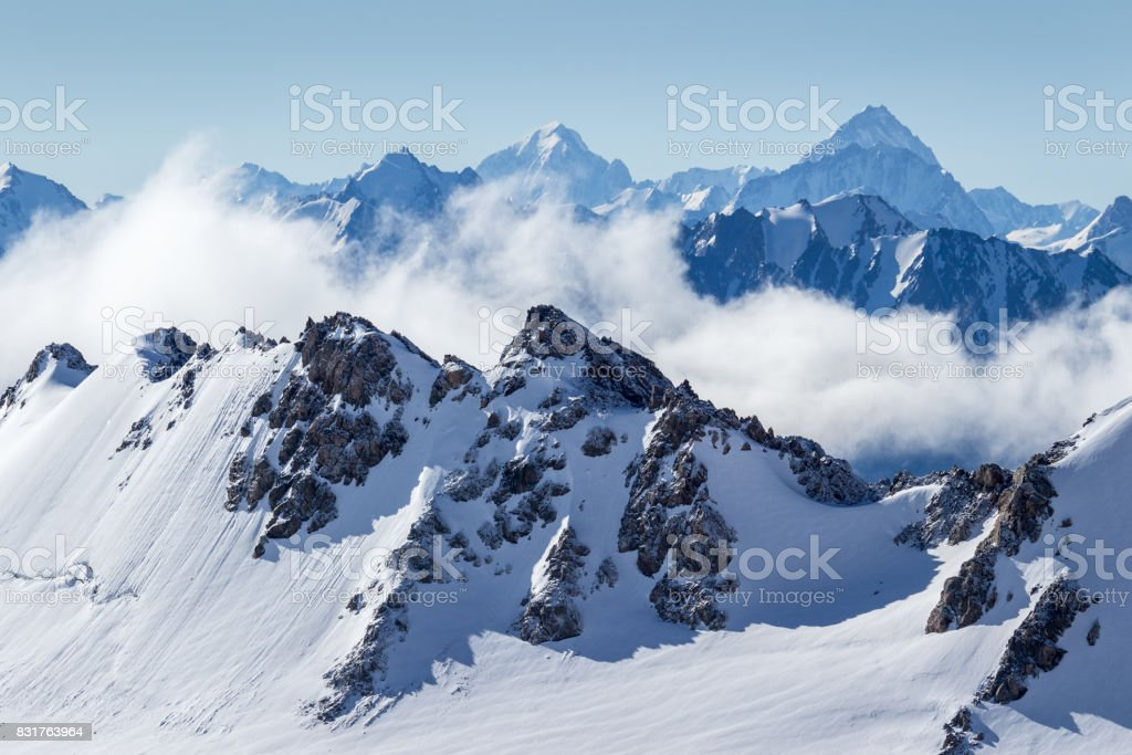 Blue snowy mountains in the morning. stock photo