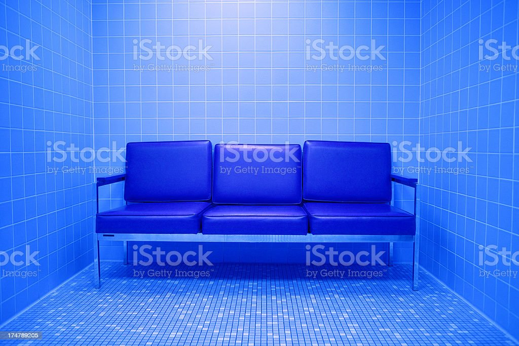 Blue Sofa in Tiled Room royalty-free stock photo