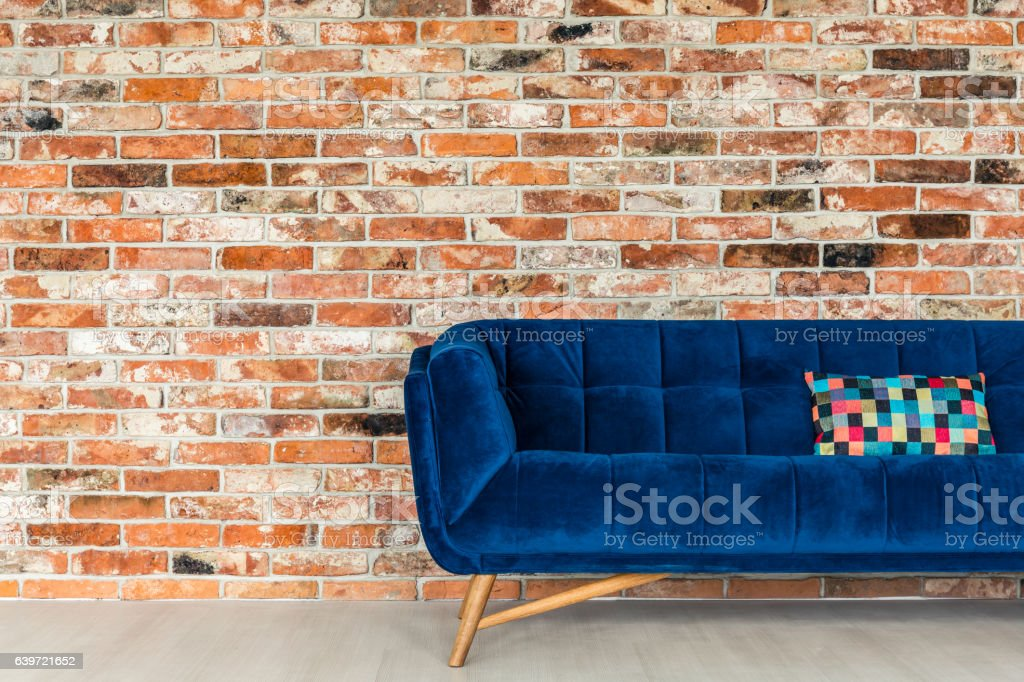 Blue sofa with patchwork pillow stock photo