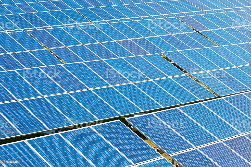 Blue solar panels on a hot sunny day stock photo