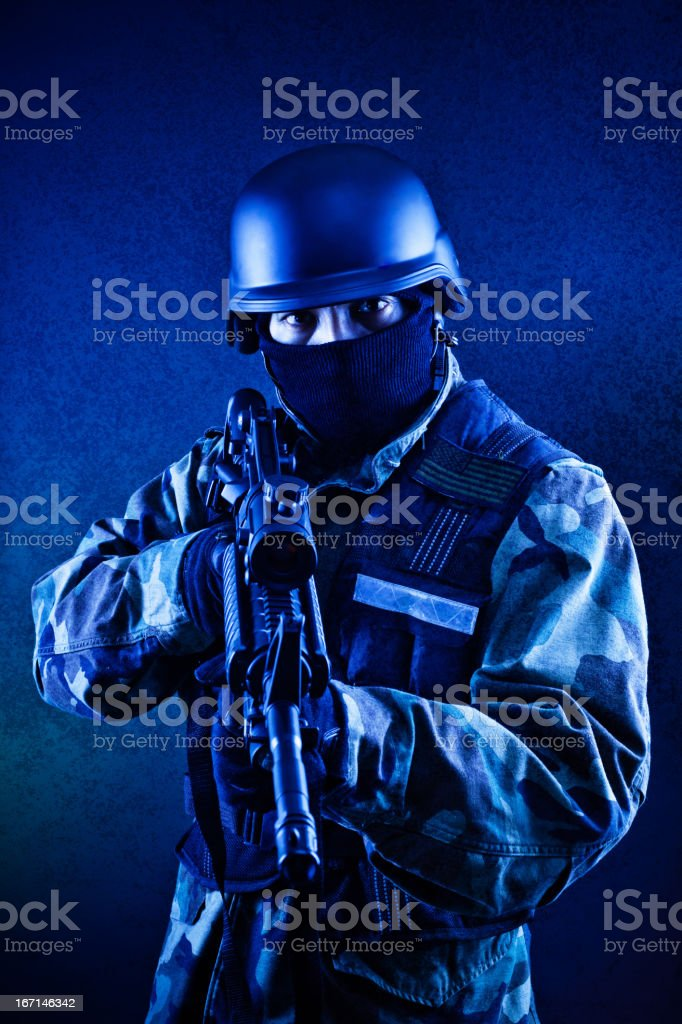 blue soldier with rifle royalty-free stock photo