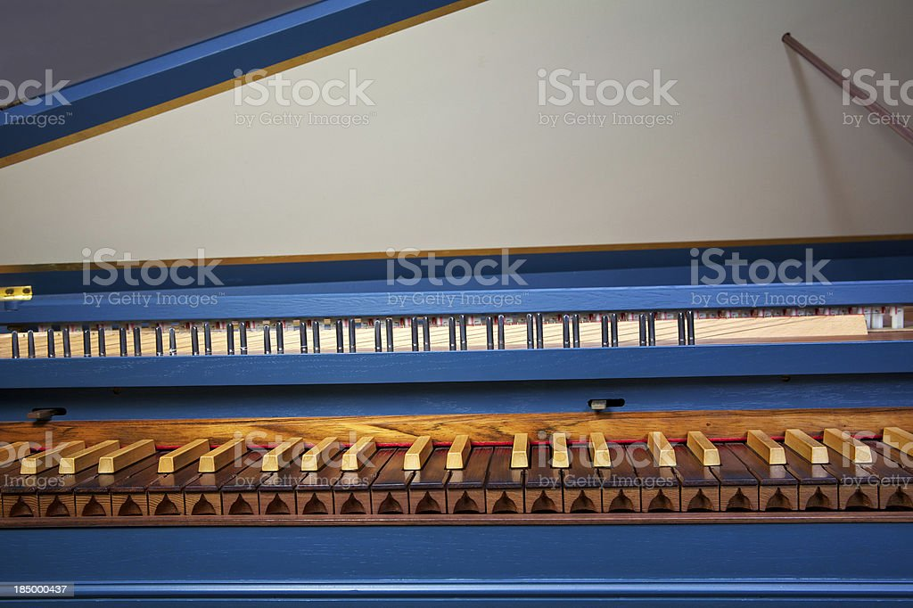 Blue spinet (harpsichord) with brown wooden keyboard stock photo