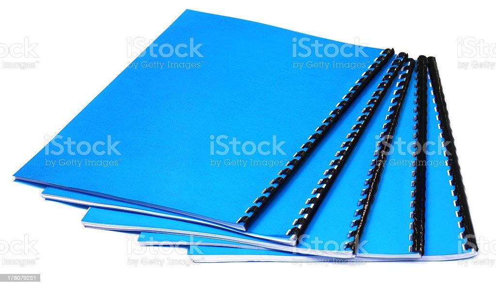 Blue Spiral bound note books stock photo