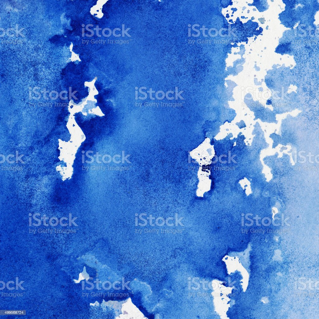 Blue splotchy watercolor and ink background stock photo