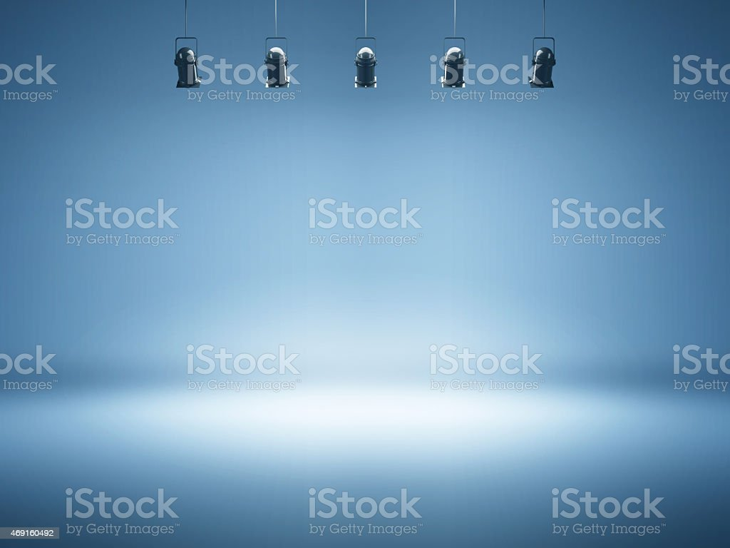 blue spotlight background with studio lamps stock photo