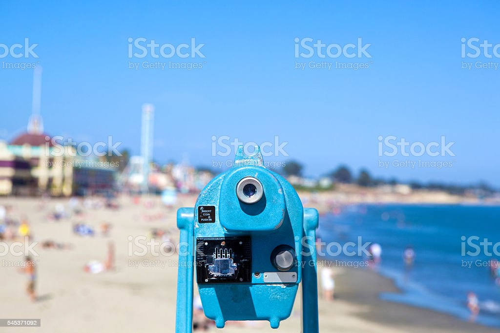 Blue Spotting Scope at a Beach stock photo