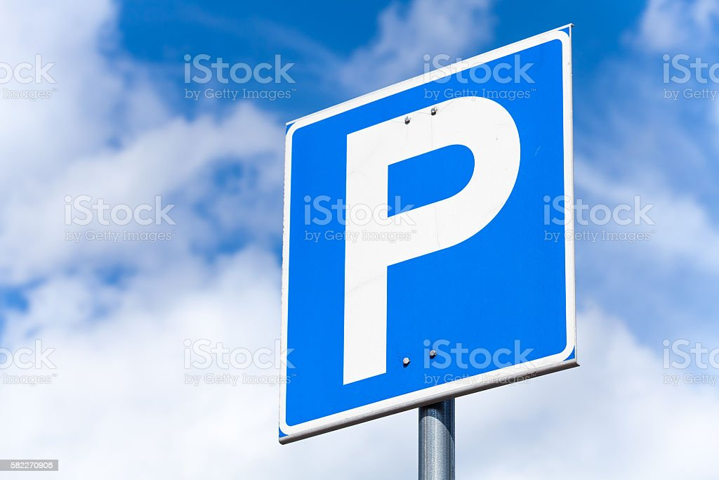 Blue square parking road sign stock photo