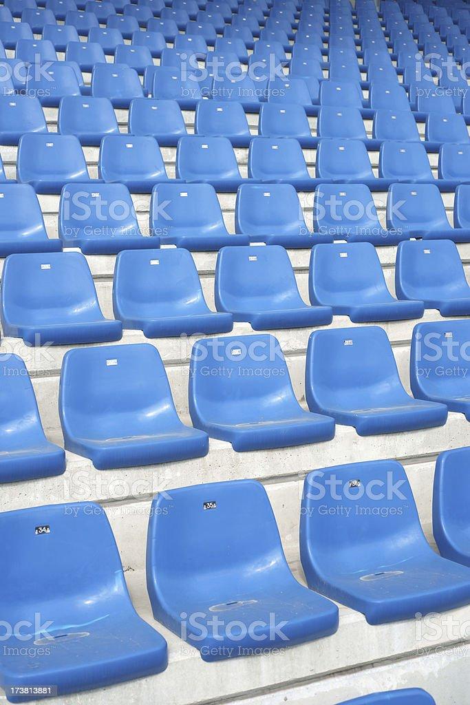 Blue stadium seats - vertical royalty-free stock photo