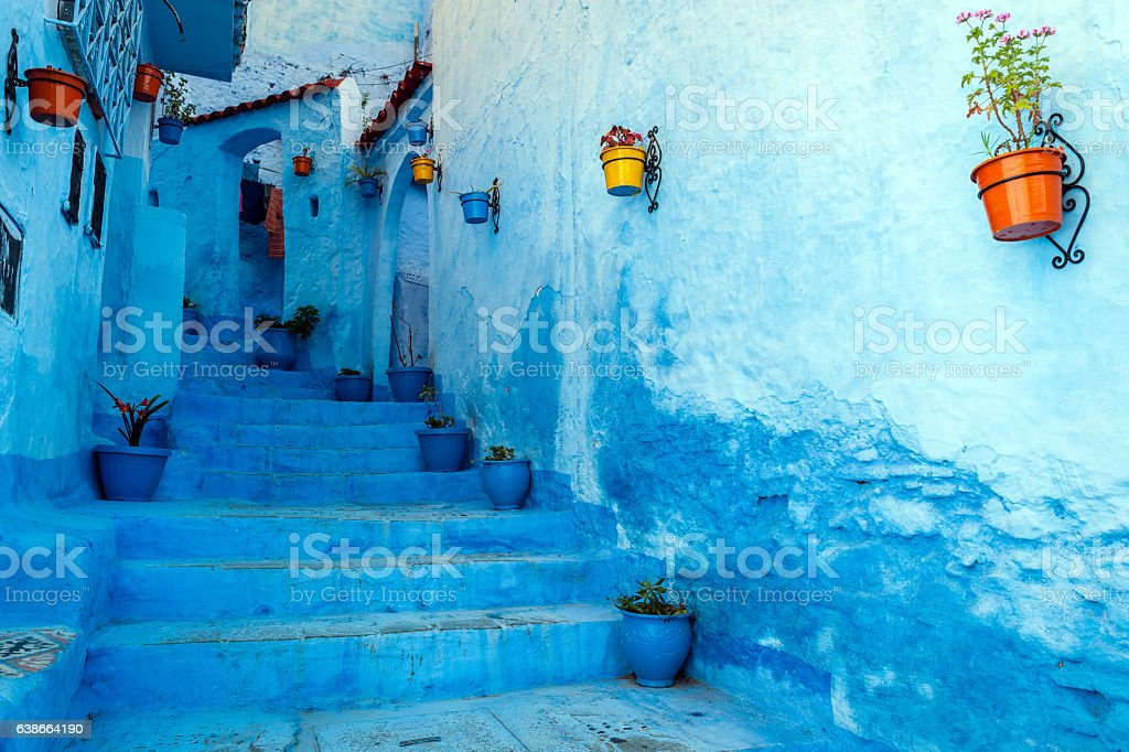 Blue staircase & colourful flowerpots, Chefchaouen,Morocco,North Africa stock photo