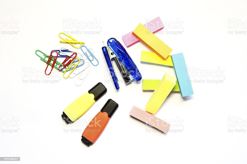 Blue stapler, colored paper clips, Two markers  and stick isolate stock photo