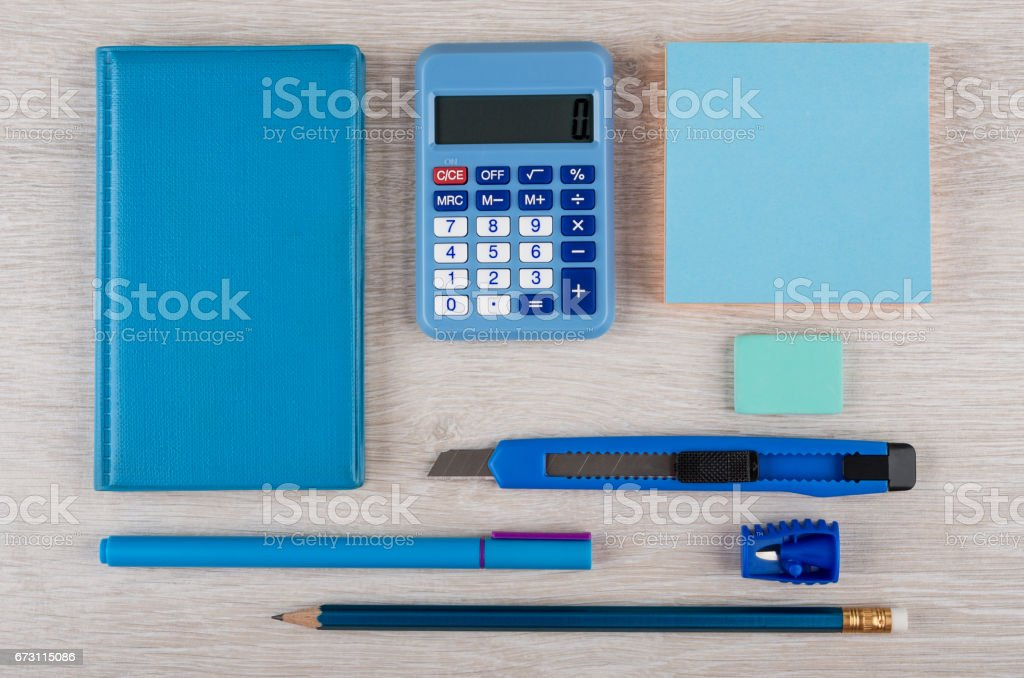 Blue stationery tools on light wooden table stock photo