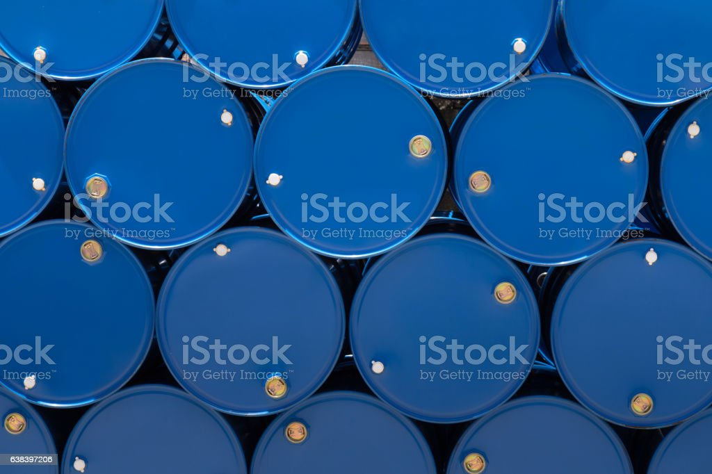 blue steel chemical tanks or oil tanks stacked in row. stock photo