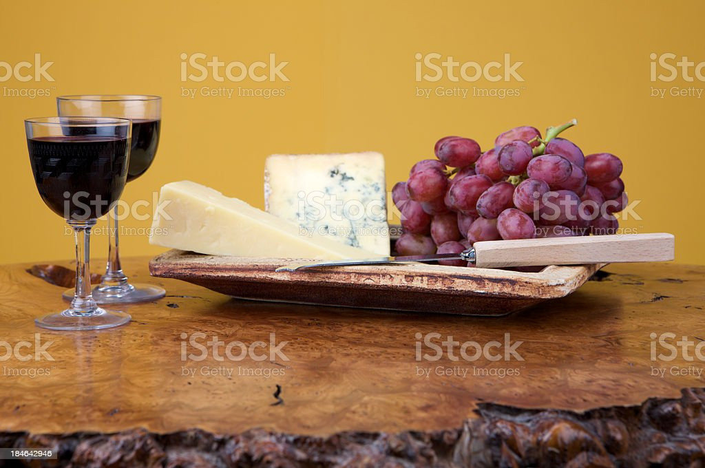 Blue Stilton, Cheddar cheese, red grapes and glasses of port royalty-free stock photo