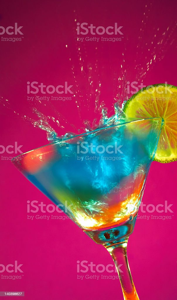 Blue storm cocktail with ice cube splash royalty-free stock photo
