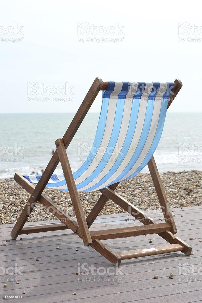 Blue Striped Deckchair on the Beach stock photo