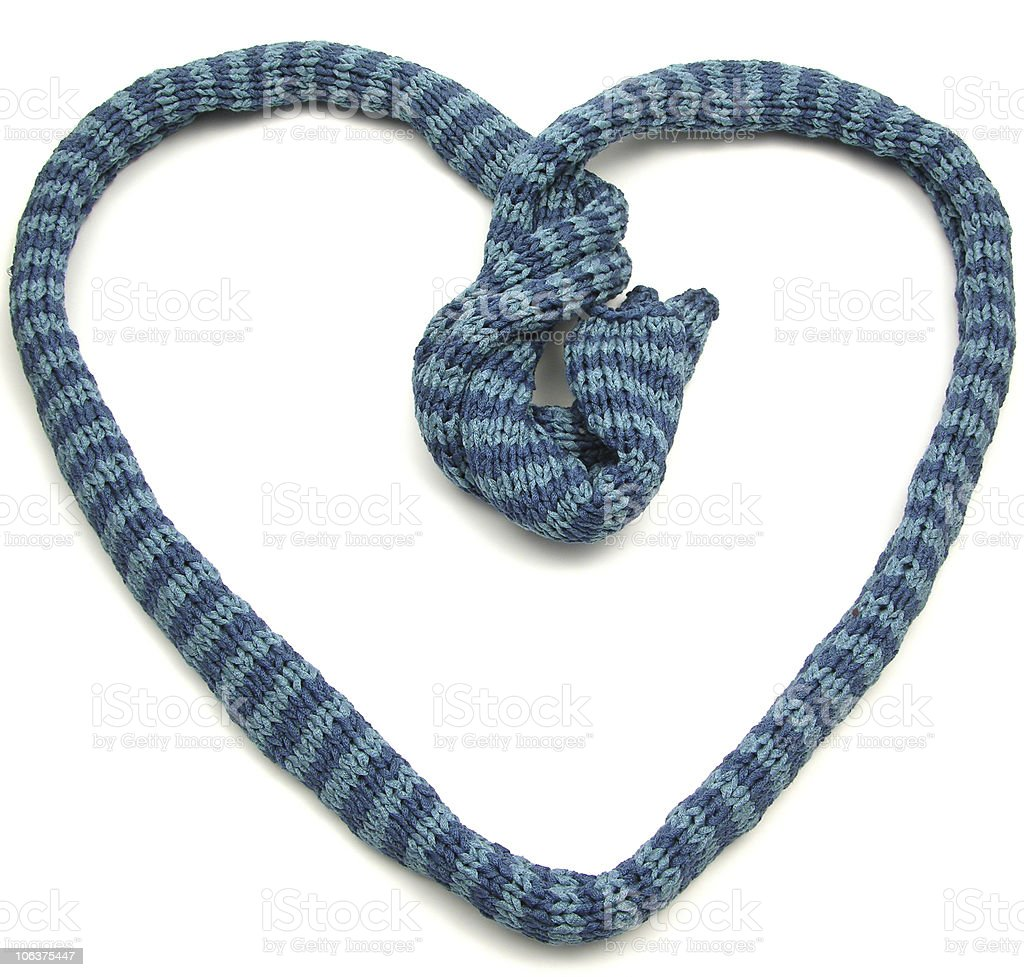 Blue striped knitting scarf arranged as heart royalty-free stock photo