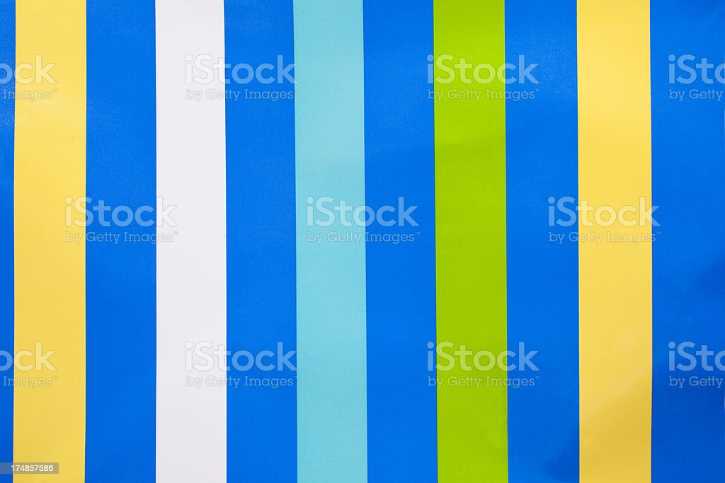 Blue striped wallpaper following multi colored pattern royalty-free stock photo