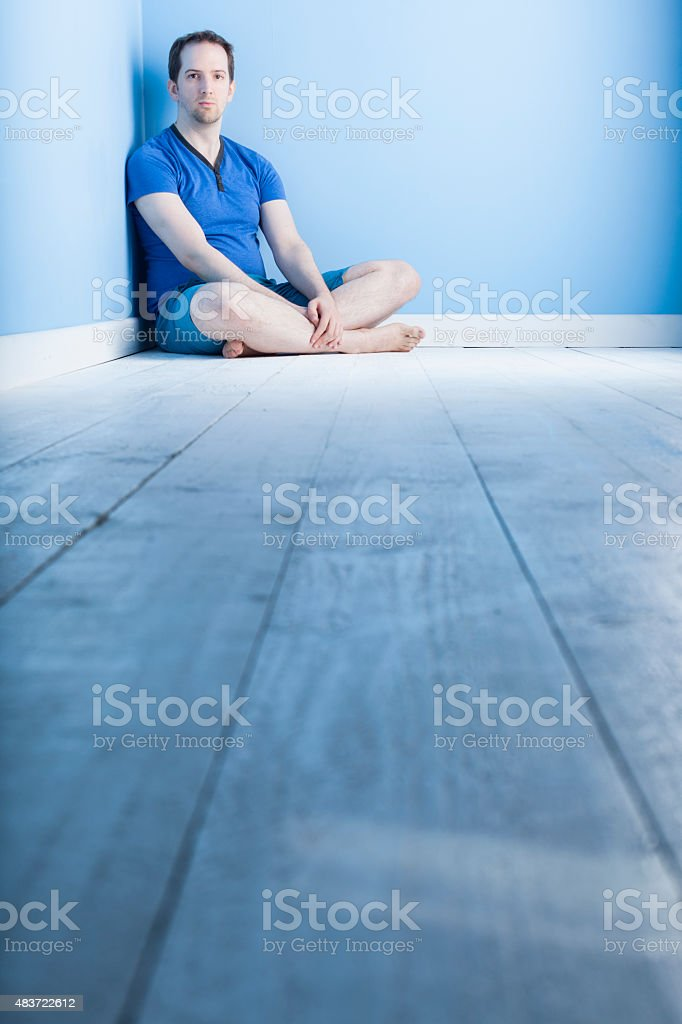 Blue Study Of A Man In His Twenties stock photo