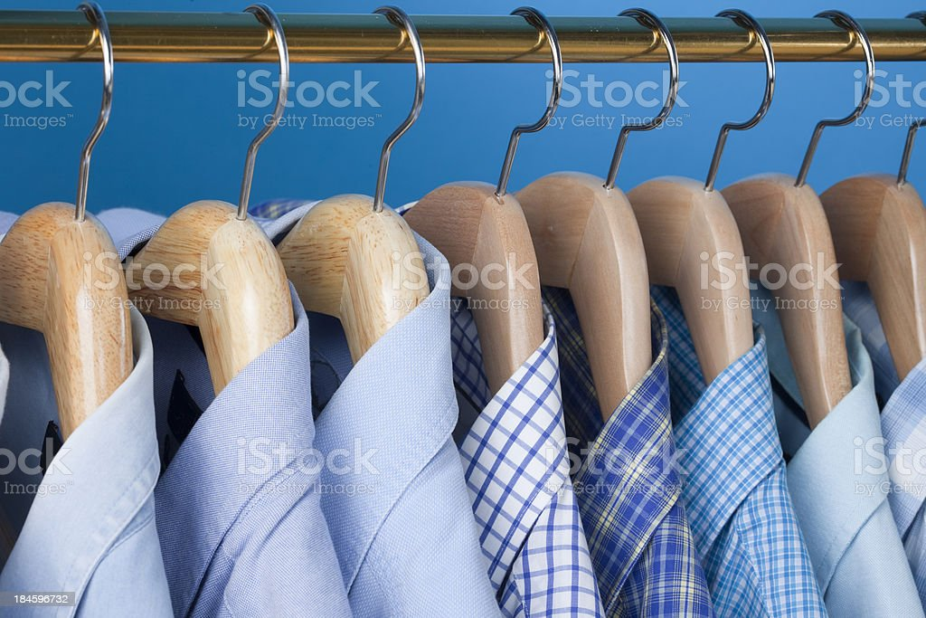 Blue Study Of Clothes On A Rail stock photo
