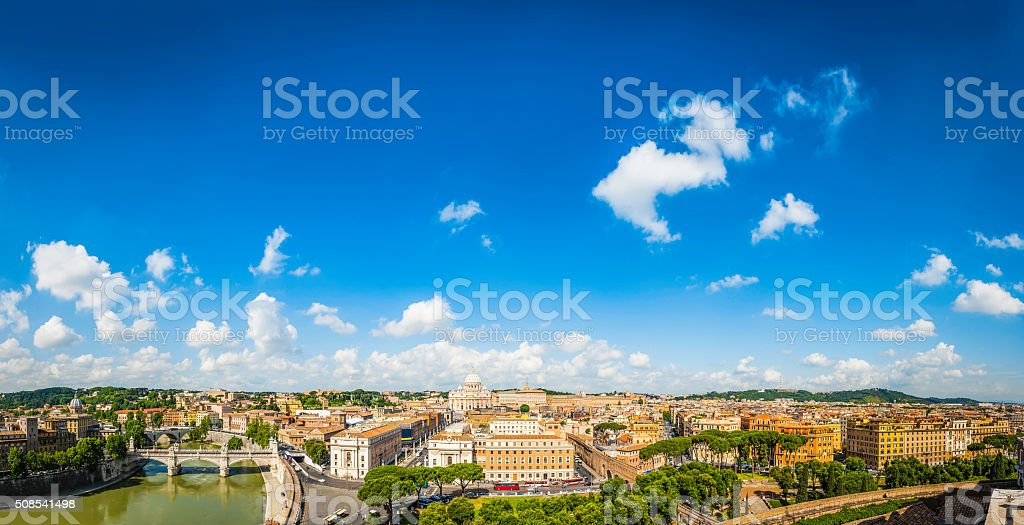 Blue summer skies over rooftops Rome and Vatican City Italy stock photo