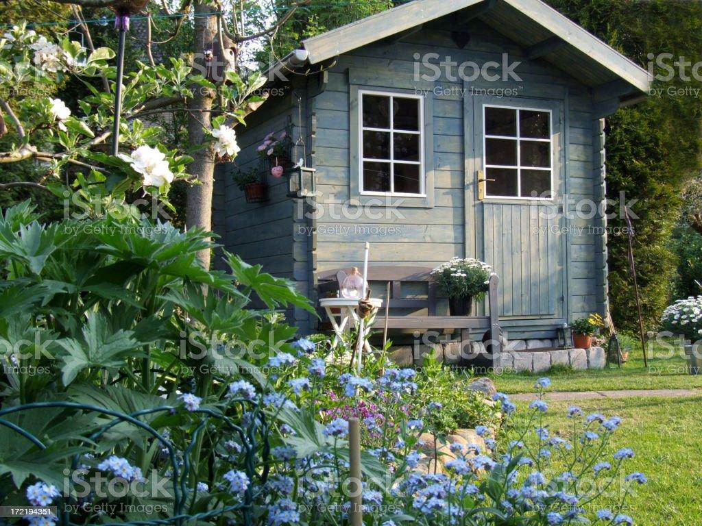 Blue summerhouse stock photo