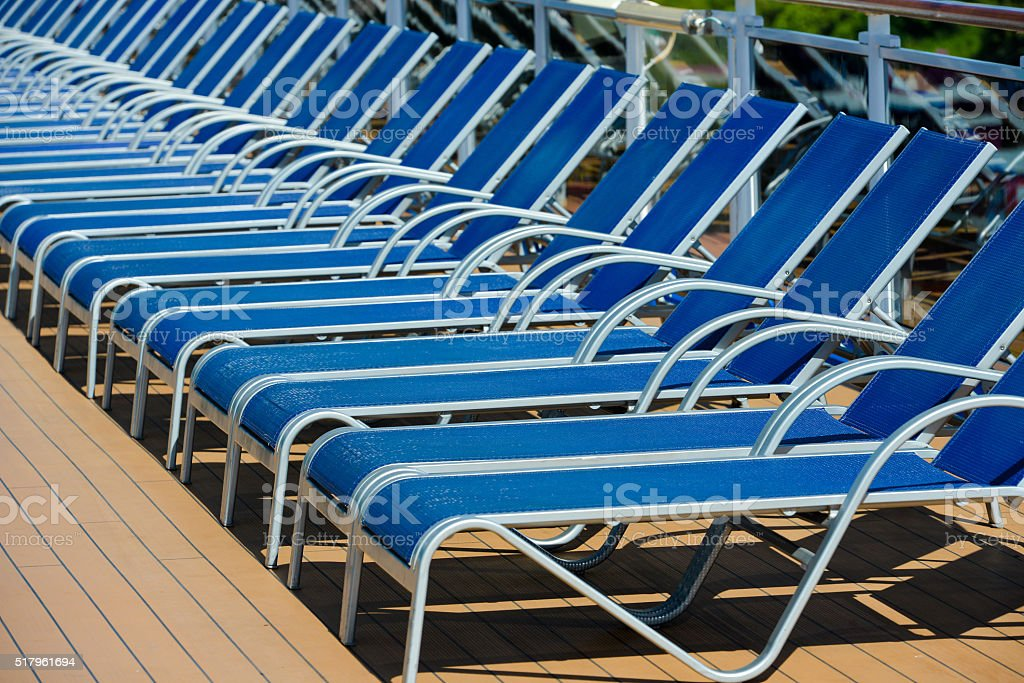 Blue sunbed into a cruise ship on summer day stock photo