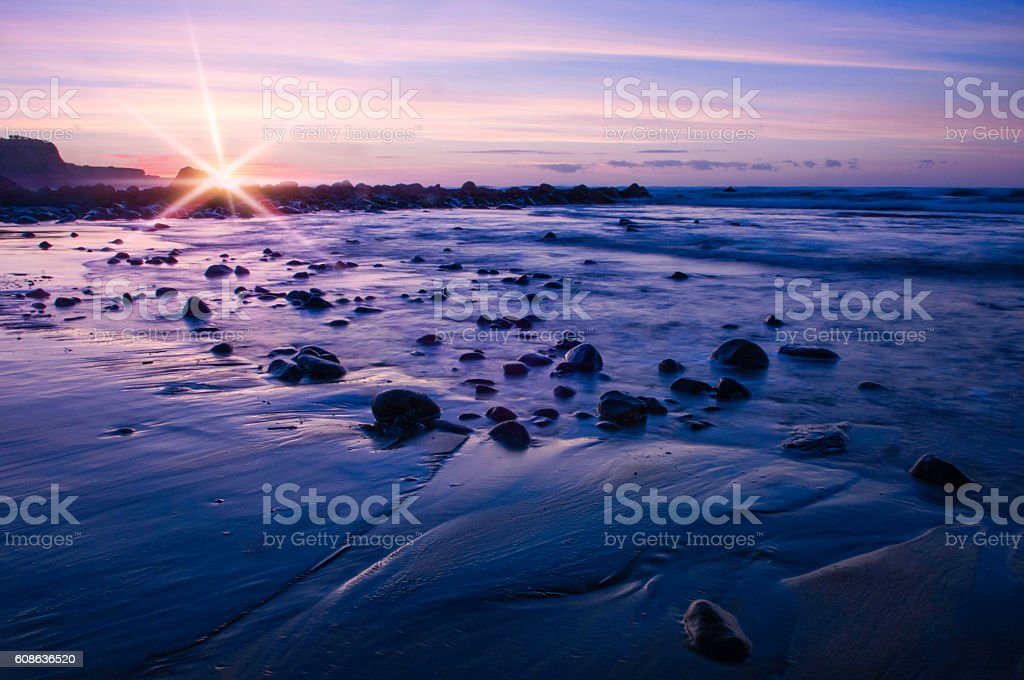 Blue sunrise with flare stock photo