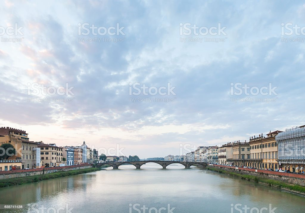 blue sunset clouds over Arno River in Florence stock photo