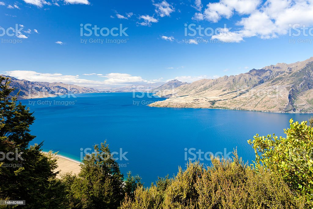 Blue surface of Lake Hawea, Central Otago, NZ royalty-free stock photo