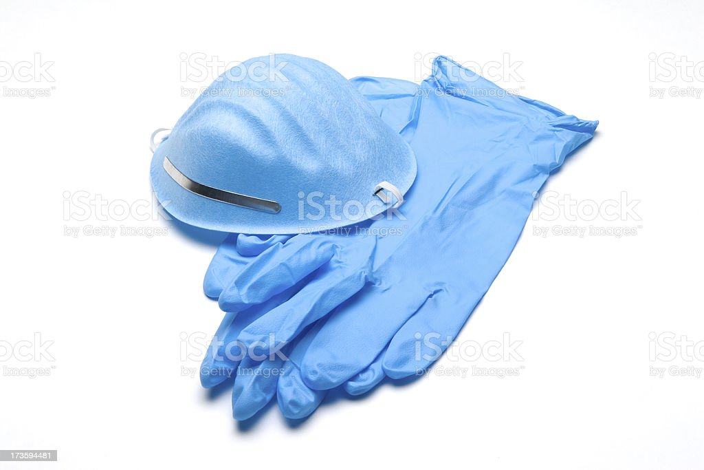 Blue surgical gloves and face mask on white background stock photo