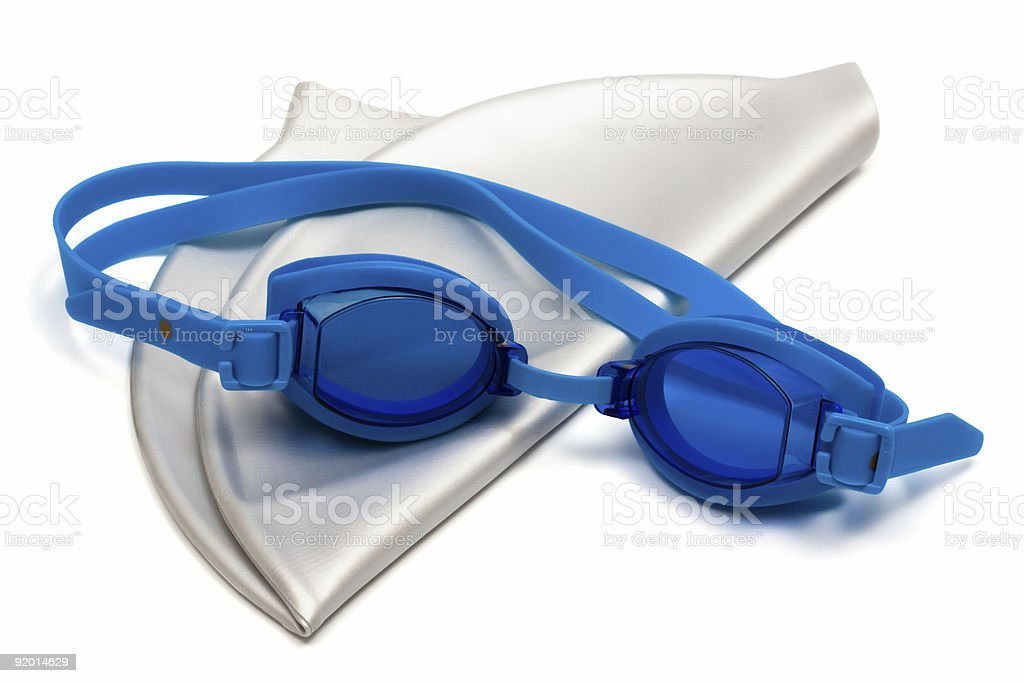 Blue swimming goggles and silver swimming cap stock photo
