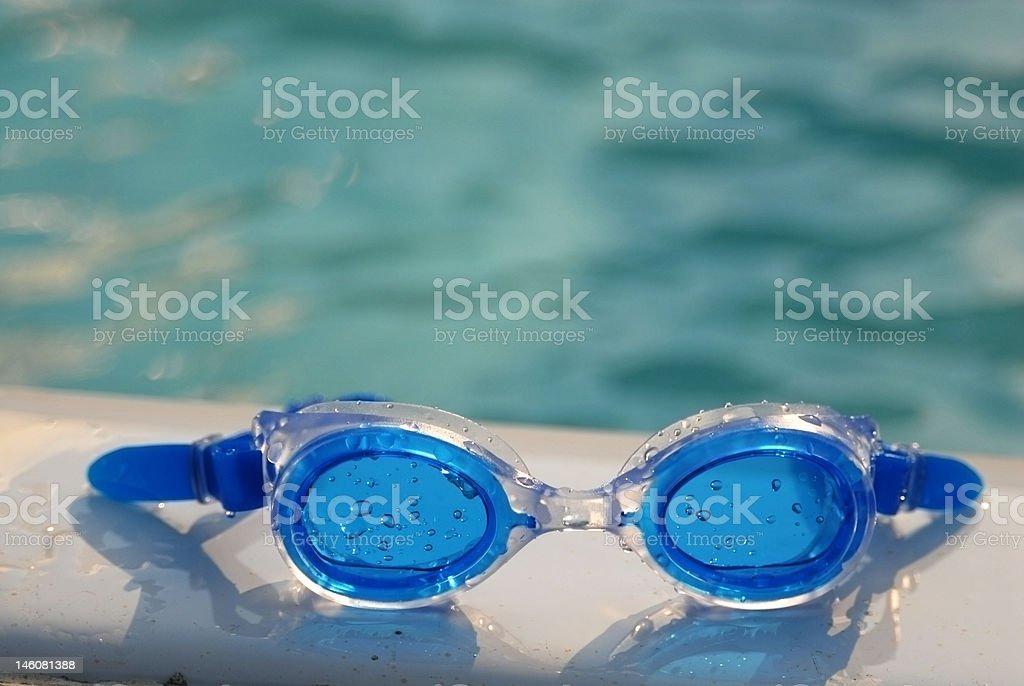 Blue swimming goggles stock photo