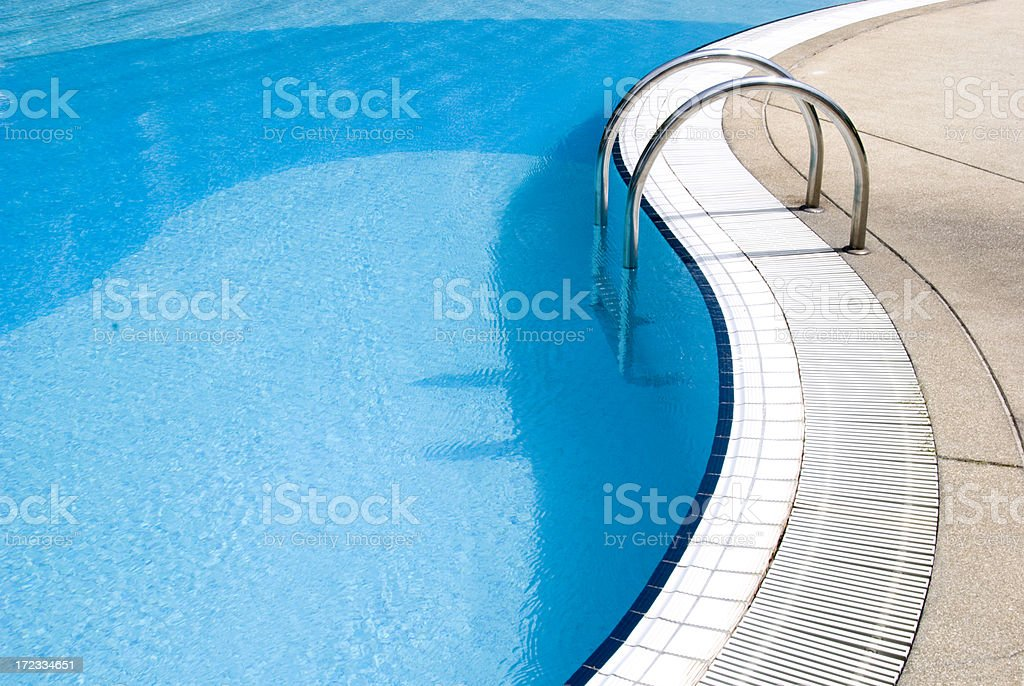 Blue swimming pool with steps royalty-free stock photo