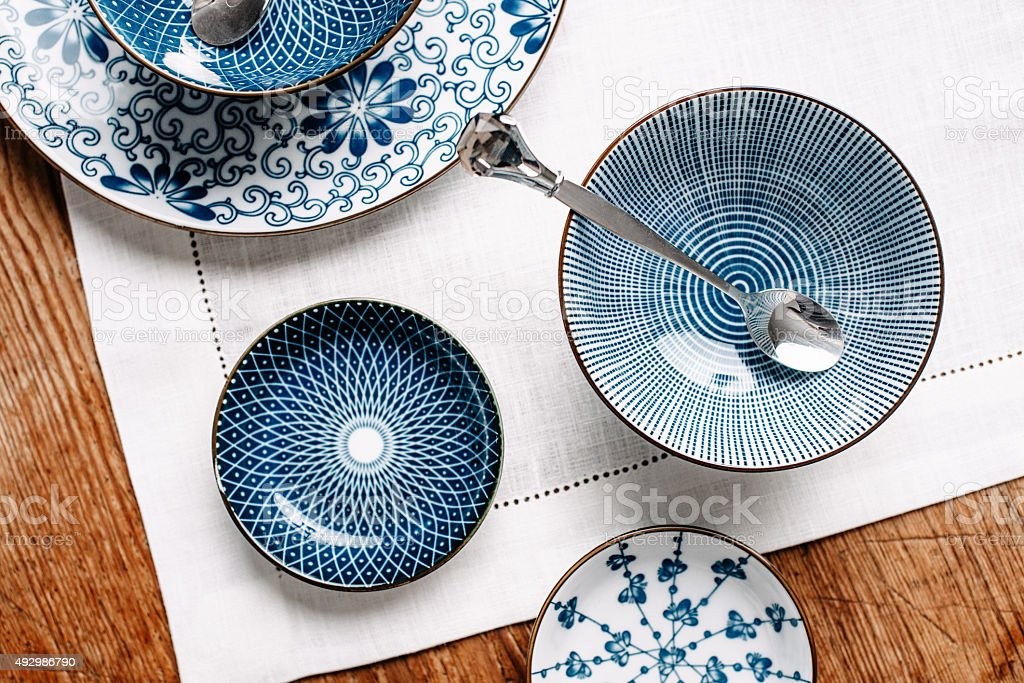 Blue table ware plates and bowls overhead stock photo