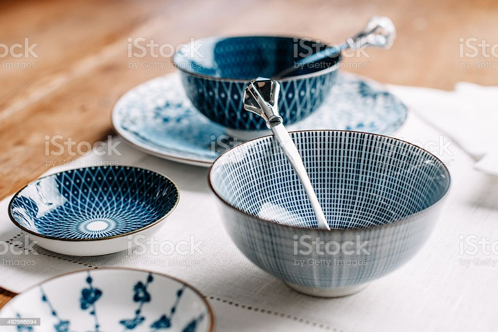 Blue table ware plates and bowls stock photo