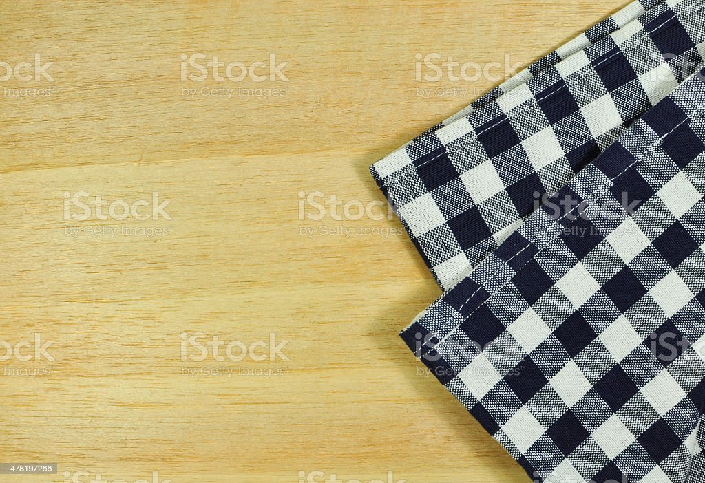 Blue tablecloth on wooden table. stock photo