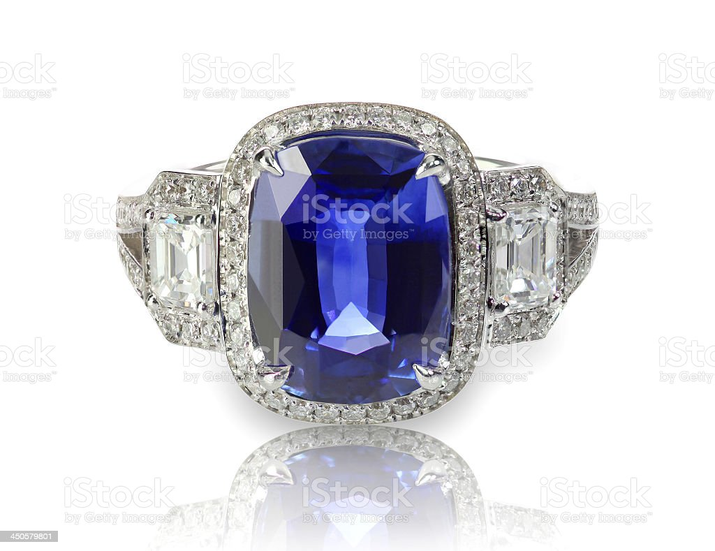 Blue tanzanite or sapphire precious gemstone and diamond ring stock photo