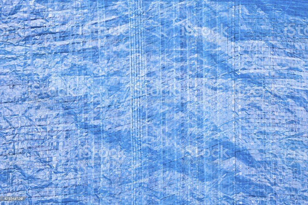 Blue tarpaulin stock photo