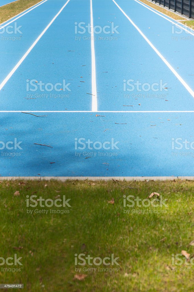 Blue Tartan race track with guide lines stock photo