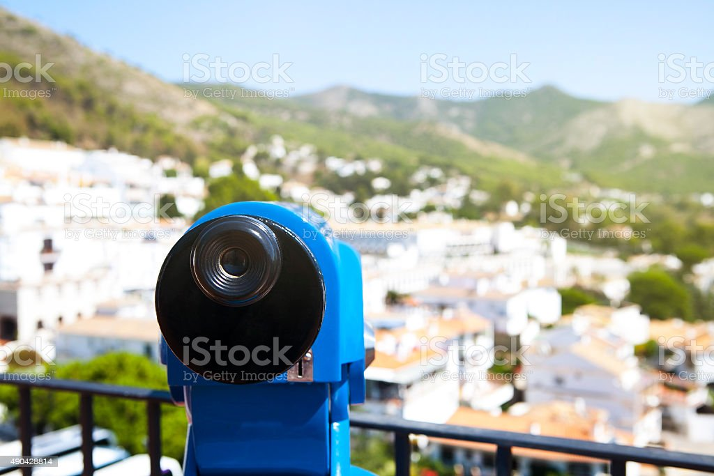 Blue telescope in a white village of Andalusia, Spain. stock photo