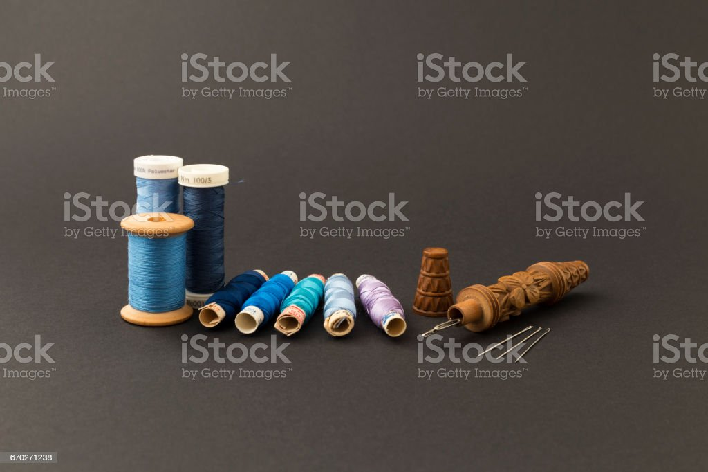 Blue thread spools with needles stock photo