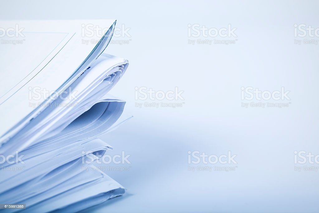 Blue tinted abstract stack of newspaper with copy space stock photo