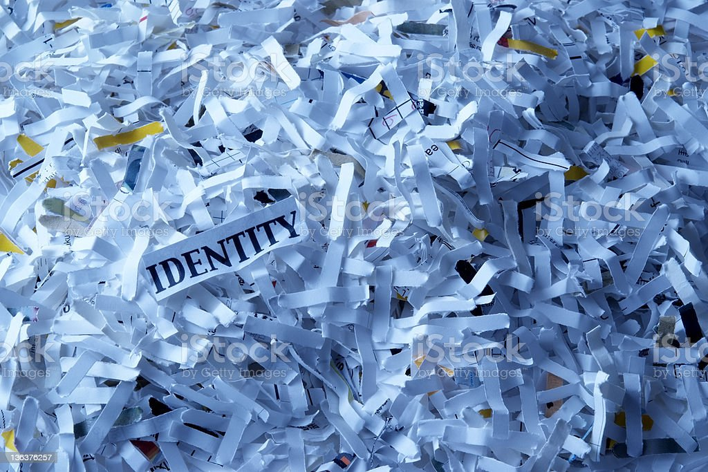 Blue tinted image of shredded documents royalty-free stock photo