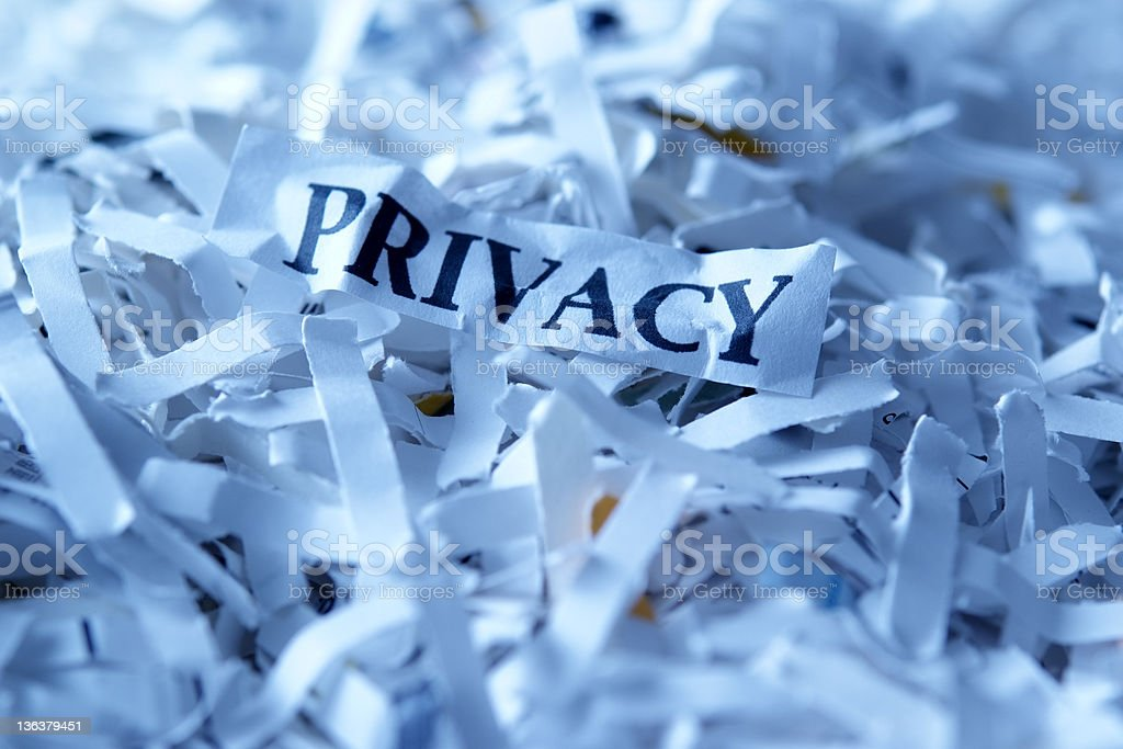 Blue tinted image of shredded privacy documents royalty-free stock photo