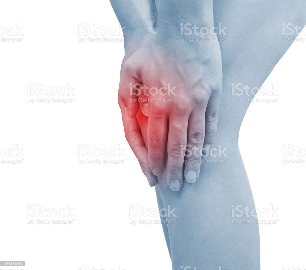 Blue tinted woman figure holding red knee to show acute pain royalty-free stock photo
