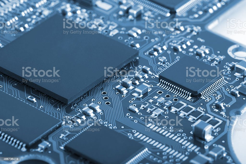 Blue toned circuit board detail stock photo