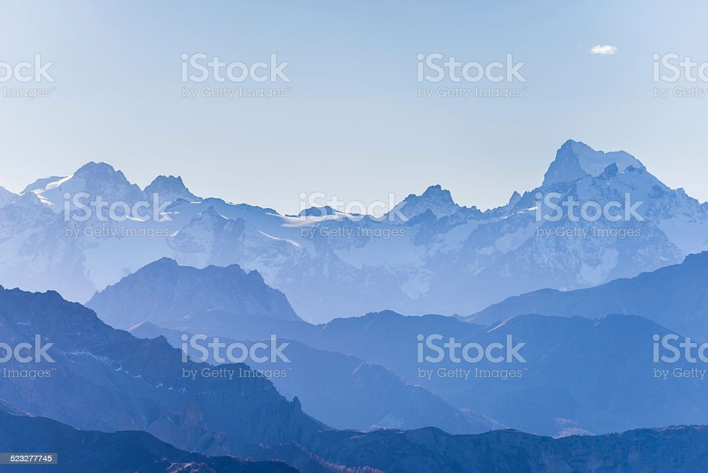 Blue toned high mountain silhouette stock photo