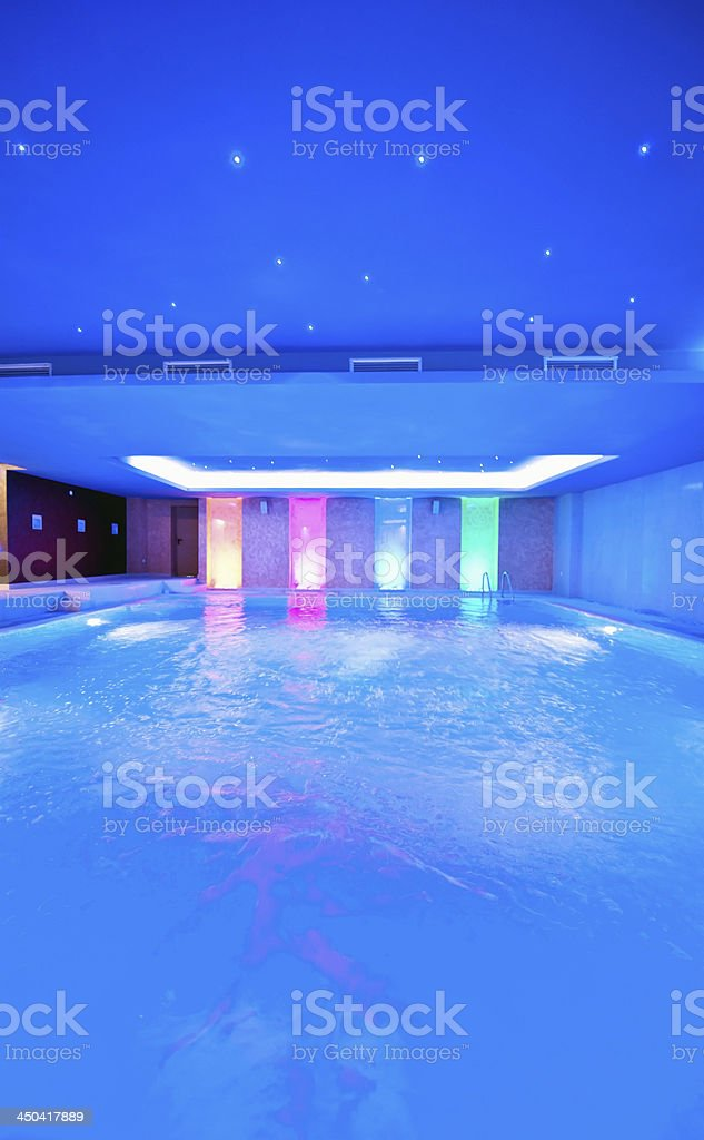 Blue toned indoor pool stock photo